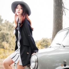 素色排釦剪裁造型翻領開襟反褶袖風衣外套.2色