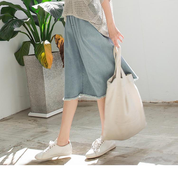 高棉牛仔下擺抽鬚設計收腰鬆緊傘襬中長裙