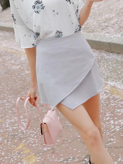 素色不規則裙襬後拉鍊包裙.2色
